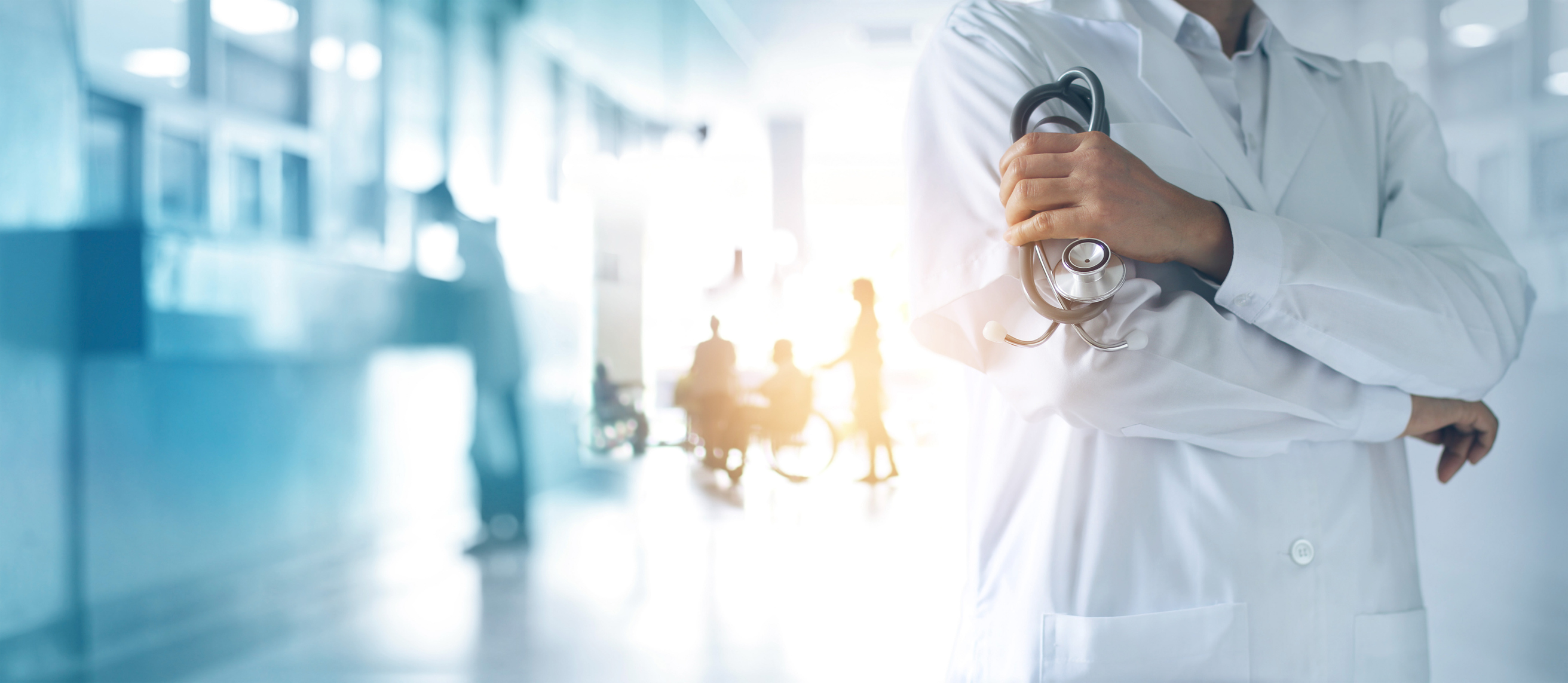 Healthcare-and-medical-concept--Medicine-doctor-with-stethoscope-in-hand-and-Patients-come-to-the-hospital-background--1023224308_2630x1145.jpeg